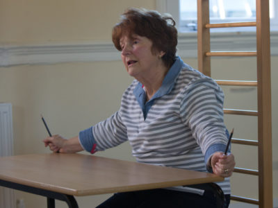 A lady with Parkinson's attends a session at Megan Baker House