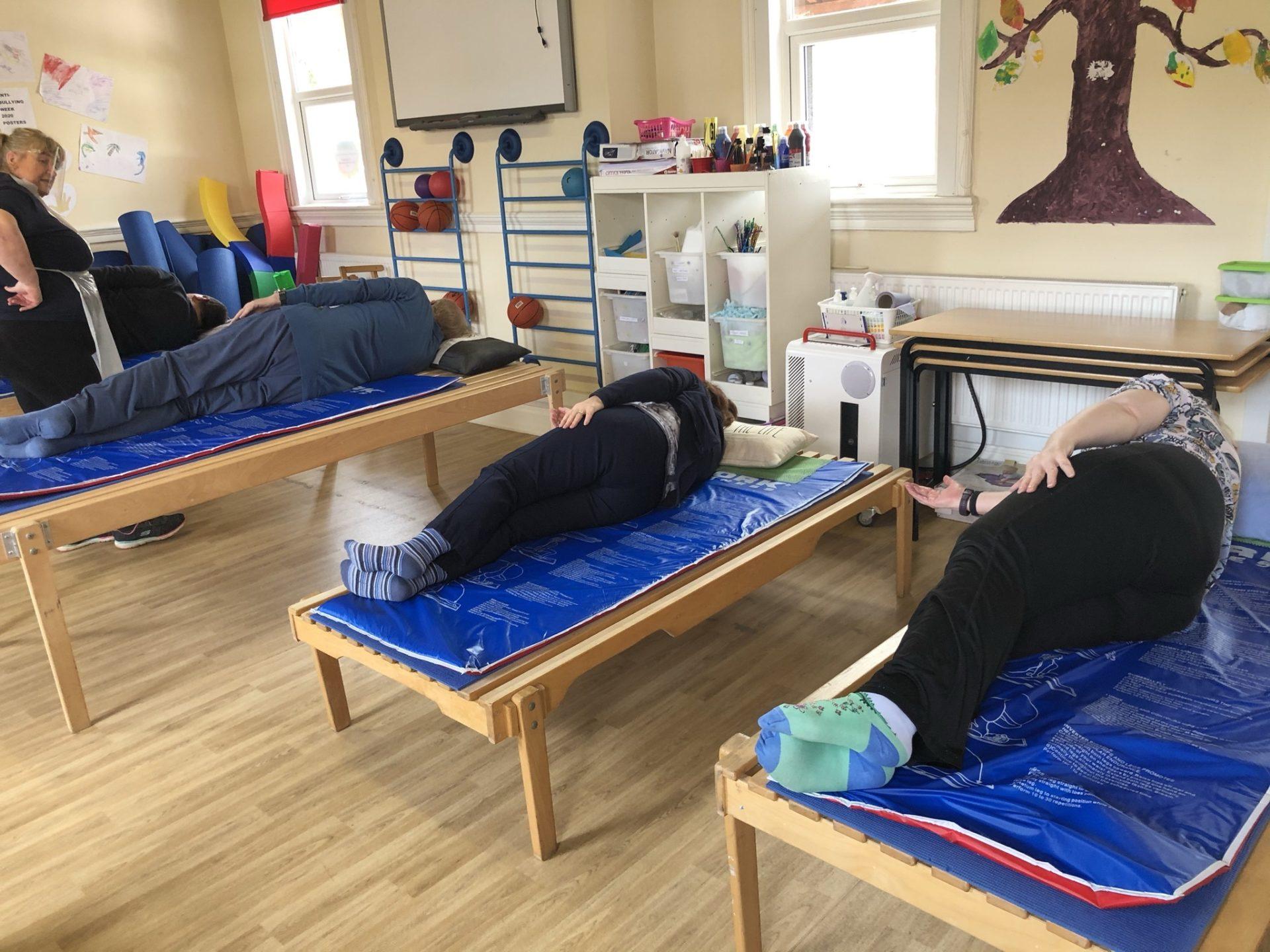 Parkinson's participants practice lying exercises at Megan Baker House